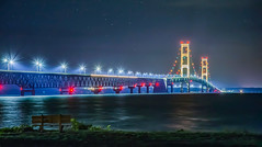 Lonely Night at the Bridge (T P Mann Photography) Tags: bridge mackinac mackinaw city michigan night sky stars light lights color bench lonely serene beach shore sea lake seascape landscape architecture structure straits canon 6d eos digital long exposure dslr tripod