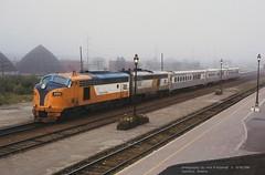 (SEE & HEAR)---ONR 2001 s, Cochrane, ONT.   9-18-1996 (jackdk) Tags: train railroad railway locomotive emd emdf7 emdfp7 emdfp9 emdf7a emdf9 f7a f7 f9 f9a fp9 fp7a fp9m fp9u fp9cat fp7au onr ontarionorthland ontarionorthlandrailway caterpillar cat passengertrain passenger cochrane cochranestation cochraneontario ontario ontariocanada fog seeandhear seehear