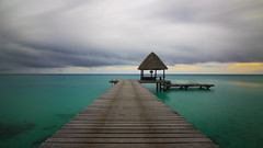 The Pier - Kia Ora Resort @ Rangiroa (Dario Manuppella) Tags: honeymoon longexposure long exposure eos 50d tokina tokina1116 nd400 hoya storm sea boat sunrise sunshine polynesia rangiroa kia ora