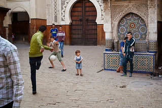 Moraccan kids playing football in Fez medina, Morocco