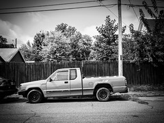 Ram power (calebbodaniel) Tags: olympus olympusomdem10markii em10markii evansville indiana evansvilleindiana micro43 m43 blackandwhite bw streetphotography neighborhood houses buildings truck car automobile old oldtruck ram rusty transportation