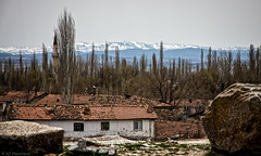The mountains still stand (The Frustrated Photog (Anthony) ADPphotography) Tags: aizanoi category flickrpost landscape places snow templeofzeus travel turkey ruins village sky cloudysky hills trees peaks canon550d canon canon1585mm cottage houses outdoor travelphotography landscapephotography