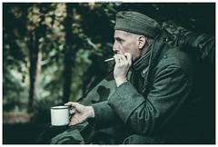 A Moment Of Relaxation (Brian P Slade Photography) Tags: wartime german soldier army cinematic brianpsladephotography brianpslade canon canonphotography candid hughendonmanor nationaltrust 1940s cigarette cup war campsite tent people portrait relaxation vintage male armyclothes woods smoking