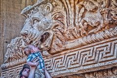 Who has more teeth? (Pejasar) Tags: child boy lift lion mouth countingteeth lebanon ruins carvings roman ancient baalbek