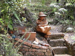 Pottery sculpture (Daniel Menzies) Tags: statue sculpture pottery clay steps mansmokingpipe smoking pipe brick art hat plants nature railway barrybrickell drivingcreek drivingcreekrailway coromandel newzealand sonydschx1