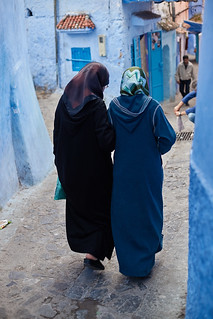 Veiled women in djellaba walking in medina, Chefchaouen, Morocco