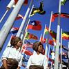 Two young women in front of flags at Place des Nations, Expo 67, on opening day / Deux jeunes femmes devant des drapeaux à la Place des Nations, le jour de l'ouverture d'Expo 67 (BiblioArchives / LibraryArchives) Tags: lac bac libraryandarchivescanada canada expo67 montreal quebec montréal québec podcast ballad women femmes flags drapeaux placedesnations april271967 27avril1967