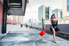 Walking The Inflatable Pet (Jon Siegel) Tags: nikon d810 sigma 24mm 14 sigma24mmf14art sigmaartlens woman girl beautiful chicken inflatable asia afternoon rooftop singapore singaporean people chinatown