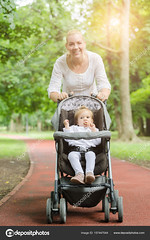 mother run or races with a baby in a stroller on the racetrack in the park (moccuradot) Tags: active activity athlete baby beautiful blonde caucasian cheerful child childhood confidence cute daughter day energetic exercise exercising family female fitness fun girl happiness happy healthy infant jogging joy kid leisure lifestyle lifestyles little love mom mother movement nature outdoor outdoors outside parent park people recreation road run running small stroller summer sunny together track training woman young