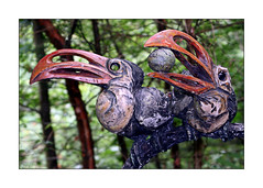 Delightful Double (paulinecurrey) Tags: smileonsaturday crazydoubles sculptures birds 2 two double pair twin beaks depthoffield closeup blur bokeh art creative colourful colours woodland trees foliage rural park contrast crazycouples nut pretty unusual different