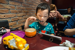 Portrait of a baby boy eating rice with a spoon in restaurant (Yinjia Pan) Tags: 23years abundance chinaeastasia digitalnative lighteffect onebabyboyonly oneperson portableinformationdevice portrait shanghai socialnetworking telephone usingphone watching wideangle wirelesstechnology babyclothing blackeye blackhair bowl carefree casualclothing cheerful child childhood chineseethnicity concentration curiosity cute dish domesticlife eating emoticon enjoyment exploration facialexpression frontview happiness headshot horizontal indoors innocence joy lifestyles partof photography playful relaxation restaurant rice simpleliving sitting smartphone spoon toy umbrella 上海市 中国 cn