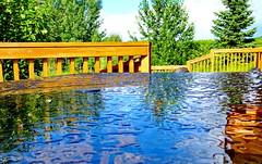 Water Art (peggyhr) Tags: peggyhr reflections railing glasstable trees rainwater bluebirdestates alberta canada thegalaxy thegalaxystars thegalaxystarshall0ffame