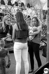 Feeding Time (Frankhuizen Photography) Tags: feeding time budel netherlands 2017 street straat candid woman vrouw kid baby bottle fles zwart wit black white zw bw fotografie photography monochrome people