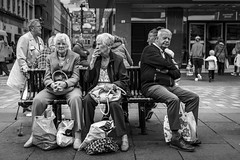 The Gender Gap (Leanne Boulton) Tags: monochrome people urban street candid portrait streetphotography candidstreetphotography candidportrait streetlife sociallandscape old elderly man male woman women female face faces facial expression bench sitting smoke smoker smoking cigarette gender space tone texture detail depthoffield bokeh naturallight outdoor light shade shadow city scene human life living humanity society culture canon canon5d 5dmkiii 35mm ef2470mmf28liiusm black white blackwhite bw mono blackandwhite glasgow scotland uk