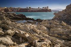 Hundreds of dragon flakes. (Emykla) Tags: mare sea rocce rocks terrasini italy italia torre tower nikon d3100 sicilia sicily south sud costa blue stone teal