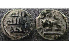 Umayyad fals of Tabariya, overstruck on a Roman coin (Baltimore Bob) Tags: money coin ancient copper bronze fals umayyad caliphate tabariya tiberias palestine israel kalima pictorial lion overstrike overstruck roman constantinian