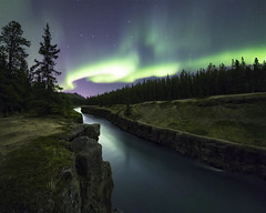 From the River to the Sky (andrewpmorse) Tags: night nightlights nightsky stars starscape aurora auroraborealis northernlights canyon river leadinglines sky landscape landscapes whitehorse yukon yukonterritory yukonriver milescanyon cliffs canon 5div canada northerncanada longexposure rokinon14mmf28
