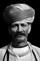 Rajasthani Performer (Rk Rao) Tags: newdelhi delhi india portrait people rajastani performer traveler monochrome blackandwhite places truelife dailylife