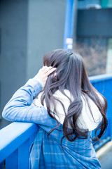A Girl Takes Photos (Dick Thomas Johnson) Tags: japan tokyo shibuya harajuku 日本 東京 渋谷 原宿 横断歩道橋 歩道橋 footbridge highschoolgirl 女子高生 jk highschoolstudent 高校 高校生 highschool student
