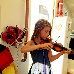 Z's new shoes and DB practicing violin. We bribe her.