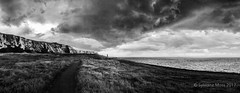 Stormy sky on the Kent coast (Sylviane Moss) Tags: uk england kent samphirehoe cliffs storm sky clouds rain weather sea coast coastal bw monochrome silverefex noirblanc chalk