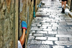 one shoe blues (stellagrimsdale) Tags: blue shoe alley dubrovnik city lady foot crock tan relaxing limestone history colours leg