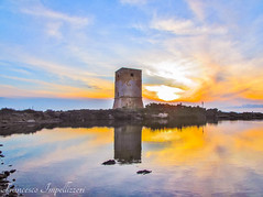 The Tower (Francesco Impellizzeri) Tags: trapani sicilia sunset tower canon clouds water reflections