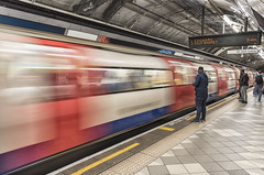 Off to Edgeware (David Feuerhelm) Tags: nikkor movement underground station people platform london sign longexposure wideangle coorefex colour colourful nikon d750 man waiting text