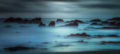 Surreal Seascape (Mick Blakey) Tags: shoreline slowexposure rugged cornish mist rocks sea cornwall azure beach panoramic relaxing silhoette coast coastal rocky blue seascape tranquil misty whitsandbay surreal