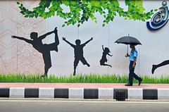 Let's make our living place more green! (ashik mahmud 1847) Tags: bangladesh d5100 nikkor streetphotography people green design art painting umbrella man ngc