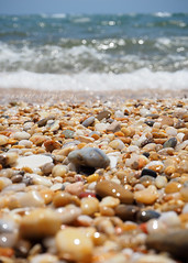 Stones and Surf (.annajane) Tags: portugal algarve stones beach coast sea waves water ocean stoneybeach pedras costa praia praiadaouraleste ondas onda albufeira bokeh