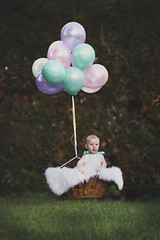 Floating away (taylormackenzie) Tags: nikon d7200 north carolina balloons hot air balloon outside sunlight green baby girl toddler daughter basket fantasy portrait children birthday remember me photography charlotte dallas nc