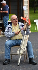 31st Annual Saint Elizabeth Catholic Church Pork Out (rabidscottsman) Tags: scotthendersonphotography man elderly music musician smile people peoplewatching musicalinstrument chair sitting bell washboard woodenblock mn minnesota elizabethminnesota northwesternminnesota festival minnesotatwins parkinglot sunday weekend churchdinner nikon nikond7100 d7100 tamron tamron18270 sunglasses spring stick drumstick day232 bluejeans socialmedia capturedmoment