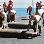 Vietnam War 1966 - Bombs Being Rolled Along Deck of USS Constellation thumbnail