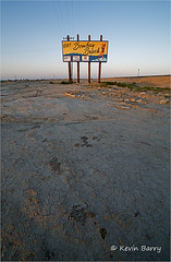 Just after sunrise on the road to Bombay Beach (Kevin B Photo) Tags: kevinbarry bombaybeach thesaltonsea california morning vertical landscape billboard bleak decay west western daytime blue sky wideangle spring springtime usa america cracks cracked earth road traintracks
