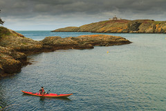 Sea Kayak at Point Lynas (Howard 'H' Pimborough) Tags: howardhpimborough canon7d 1740mmf4l point lynas anglesey cymru clouds coast sea cliffs cliff waves water wales kayak lighthouse rocks rock f16 explored northwales sport adventure travel