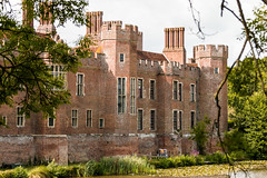 Walls, towers, windows and chimneys (Keith in Exeter) Tags: herstmonceux castle wall tower window chimney crenellation battlement brick fort fortification moat lake tree outdoor sussex england english