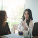 Two women participate business meeting