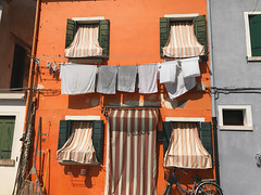 Burano 41 (ValterB) Tags: euro2017 2017 venice iphone landscape lines light scenic street summer shadow streetphotography window wall travel magical tourism beautiful scenery extreme adventure tourist lonely sun hot solitude heat colors colour building architecture facadelines abstract urbanphotography urbanart urban photography paintedstreetwalls burano italy italia venezia windows clothes stripes shade orange grey dry drying valterb bright design family flickr holiday trip buildings exposure