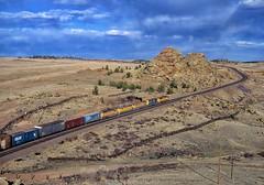 Sherman Hill (rolfstumpf) Tags: usa wyoming shermanhill unionpacific desert clouds sky freighttrain trains railway fujichrome landscape rdp100 railroad mamiya rocks granite tracks