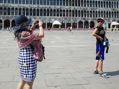 Snap 039 (Peter.Bartlett) Tags: bag tourists people city urbanarte boy cellphone hat urban child woman mobilephone ricohgr lunaphoto streetphotography peterbartlett facade venezia veneto italy it