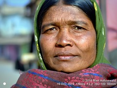 2016-12e Jagdalpur Sanjay Market (05) (Matt Hahnewald) Tags: facingtheworld photo image naturalframe faceperception physiognomy psychological nikond3100 nikkorafs50mmf18g primelens 50mmlens 4x3aspectratio street portrait closeup faceshot seveneighthsview lowangleshot cultural character personality realpeople humanhead nose nosepiercing nosestuds facialexpression eyecontact headscarf headcovering consent encounter ethnicportrait tourism travel travelportrait ethnic tribal villager market marketwoman indianwoman maturewoman tribalmarket sanjaymarket jagdalpur bastardistrict chhattisgarh india oneperson female posing scrutinizingeyes color eyes outdoors face adivasi horizontalorientation matthahnewaldphotography