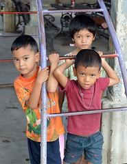 boys and bars (the foreign photographer - ฝรั่งถ่) Tags: three boys metal bars playground equipment khlong thanon portraits bangkhen bangkok thailand nikon d3200