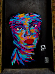 Holy Mahyoly (Steve Taylor (Photography)) Tags: mahyoly hnrx zdey art graffiti mural pasteup wheatup wheatpaste streetart sticker portrait door colourful vivid brick paint paper lady woman uk gb england greatbritain unitedkingdom london peelingoff face
