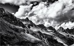 Slopes in the Light... (Ody on the mount) Tags: anlässe berge em5ii himmel hänge lichteinfall mzuiko2518 omd olympus urlaub wanderung wolken bw clouds hiking monochrome mountains sw sky slopes gaschurn vorarlberg österreich at