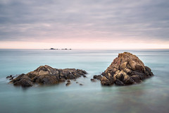 Smell The Sea And Touch The Sky. (Andy Bracey -) Tags: jersey channelislands englishchannel landscape seascape larocque longexposure tenstop bigstopper leefilters nikon coast coastal rocks smelltheseaandtouchthesky evening sunset milkywaters kneedeep mystical seasalt incomingtide smooth mutedhues softpallet prettyinpink