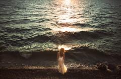 Okanagan Lake Glowing (Lichon photography) Tags: ocean water lake beauty okanagan kelowna kelownaphotographer dress sparkle standing stand female girl shore rocks waves sunset composition long hair