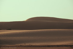 woman in prone position (Paterdimakis) Tags: desert sand woman prone position fine art red shape line nature fuji sky dune hill view beautiful light shadow