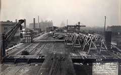 """Building what's now called """"The High Line"""" (technically, the NYC viaduct of the New York Central Railroad) in a gritty, industrial West Side of Manhattan that's now long gone and forgotten. December 1932 (wavz13) Tags: manhattanhistory newyorkhistory manhattanskyline newyorkskyline newyorkskyscapers 1930smanhattan 1930snewyork oldnewyork oldphotographs oldphotos 1930sphotographs 1930sphotos oldphotography 1930sphotography vintagephotographs vintagephotos vintagephotography filmphotos filmphotography newyorkphotographs newyorkphotos oldnewyorkphotography oldnewyorkphotos vintagenewyork vintagemanhattan vintagenewyorkphotography vintagenewyorkphotographs vintagenewyorkphotos vintagetribeca oldtribeca lowerwestside vintageconstruction oldconstruction oldmeatpackingdistrict vintagemeatpackingdistrict industrial industrialphotos industrialphotography oldfactories vintagefactories dreary bleak noir noire dark oldbuildings vintagebuildings railroadphotos railroadphotography railroads vintagerailroads vintagerailroadphotography oldrailroads oldrailroadphotography oldhighline vintagehighline highlineconstruction smokestacks vintagesmokestacks oldsmokestacks"""
