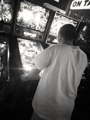 Getting Played (PhotoJester40) Tags: inside indoors ben pinball pinballmachine bnw blackandwhite blackwhite amdphotographer